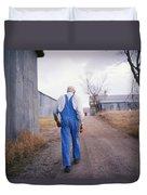An Elderly Farmer In Overalls Walks Duvet Cover