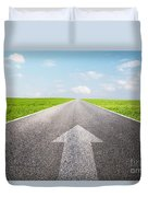Arrow Sign Pointing Forward On Long Empty Straight Road Duvet Cover