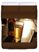 Backlit Glass Of Beer And Empty Bottle On Table Duvet Cover