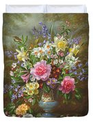Bluebells Daffodils Primroses And Peonies In A Blue Vase Duvet Cover