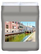 boat in a canal of the colorful italian village of Comacchio in  Duvet Cover