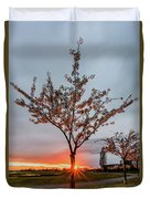 Bright Sun With Long Red Rays Shines Near The Trunk Duvet Cover