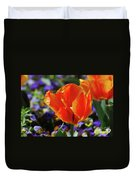 Brilliant Bright Orange And Red Flowering Tulips In A Garden Duvet Cover