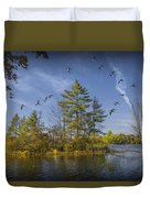Canada Geese Flying By A Small Island On Hall Lake Duvet Cover