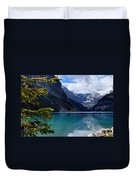 Canoe On Lake Louise Duvet Cover by Larry Ricker