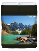 Canoes On A Jetty At  Moraine Lake In Banff National Park, Canada Duvet Cover