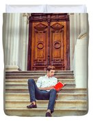College Student Reading Red Book, Sitting On Stairs, Relaxing Ou Duvet Cover