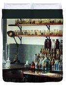 Desk With Bottles Of Chemicals Duvet Cover