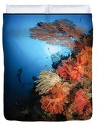 Diver Swims By A Soft Coral Reef Duvet Cover