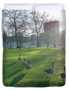 Five Ducks Walking In Line At Sunset With London Museum In The B Duvet Cover