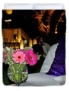 Flowers In A Vase On A White Table Duvet Cover