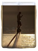 Flyboarder And Water Droplets Backlit At Sunset Duvet Cover