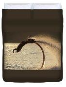 Flyboarder Doing Back Flip Over Backlit Waves Duvet Cover