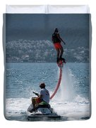 Flyboarder In Pink Shorts Above Jet Ski Duvet Cover