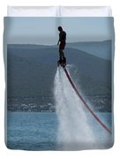 Flyboarder In Silhouette Balancing High Above Water Duvet Cover