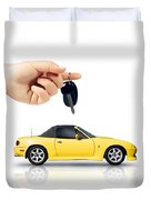 Hand Holding Key To Yellow Sports Car Duvet Cover