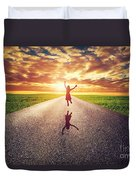 Happy Woman Jumping On Long Straight Road Duvet Cover