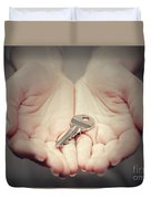 Key In Woman's Hand In Gesture Of Giving. Concept Of Success In Live, Business Solution, Real Estate Etc Duvet Cover