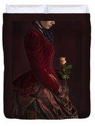 Late Victorian Woman In A Crimson Velvet Jacket And Dress Holdin Duvet Cover