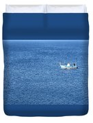 Lonely Fishing Boat Sailing On A Calm Blue Sea Duvet Cover