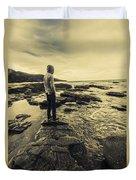 Man Gazing Out On Coastal Rocks Duvet Cover