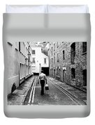 Man Walking With Shopping Bag Down Narrow English Street Duvet Cover