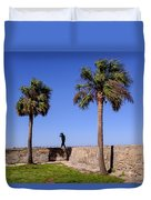 Man With A Hat On The Wall With Palm Trees In Saint Augustine Fl Duvet Cover