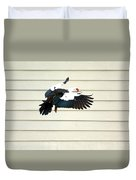 Muscovy Duck In Flight Passing A Building Duvet Cover