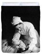 Nurse Tending To A Patient Duvet Cover