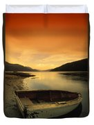 Old Rowboat At Waters Edge With Sunset Duvet Cover by Don Hammond