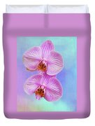 Orchid Delight - Two Blooms Against A Rainbow Background Duvet Cover