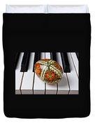 Painted Easter Egg On Piano Keys Duvet Cover