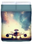 Passenger Airplane Taking Off On Runway At Sunset Duvet Cover