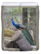 Peacock On Woodpile Duvet Cover