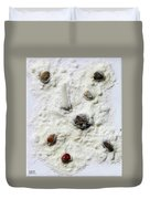 Pebbles In Snow Duvet Cover by Augusta Stylianou