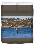 Pelican Flying Above The Pacific Ocean Duvet Cover