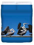 Pelicans Take Flight Duvet Cover