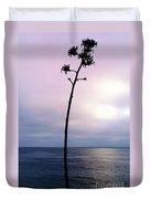 Plant Silhouette Over Ocean Duvet Cover