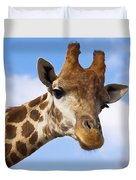 Portrait Of A Giraffe On The Background Of Blue Sky. Duvet Cover
