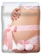 Pregnant Woman Holding Pink Baby Shoes Duvet Cover