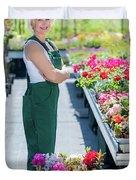 Professional Gardener At Work In A Nursery. Duvet Cover
