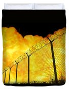 Realistic Orange Fire Explosion Behind Restricted Area Barbed Wire Fence, Blurred Background Duvet Cover