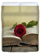 Red Rose On An Old Big Book Duvet Cover