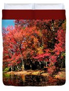 Red Trees By Lake Duvet Cover