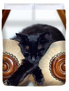 Relaxed Black Cat Sleeping Between Two Chairs Duvet Cover