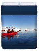 Sea Kayaking Past Icebergs Duvet Cover
