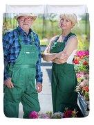 Senior Gardener And Middle-aged Gardener At Work. Duvet Cover