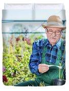 Senior Gardener Selecting A Tree. Duvet Cover