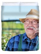 Senior Gardener Talking On The Phone With A Client. Duvet Cover