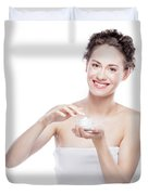 Smiling, Attractive Woman Using A Moisturizer. Duvet Cover